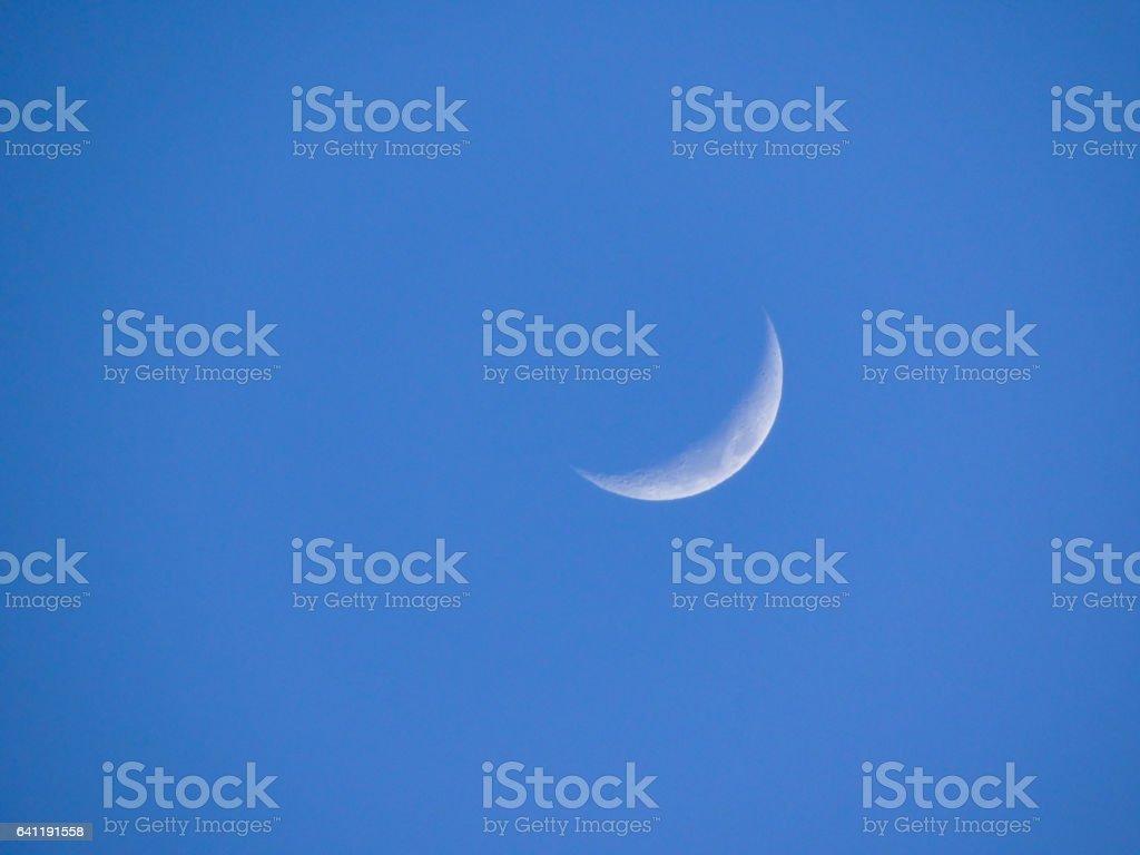 blue sky moon(cresent) stock photo