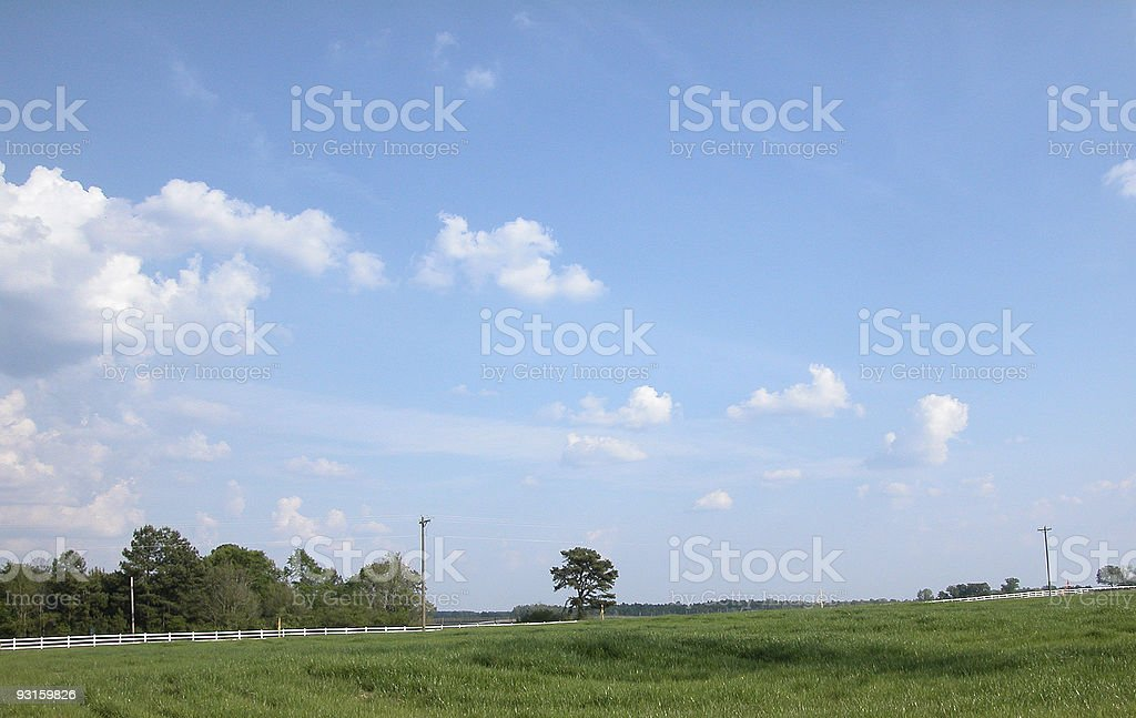 Blue Sky Over A Country Highway royalty-free stock photo