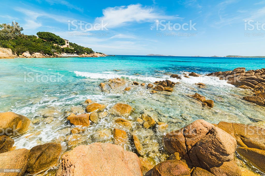 blue sky over Capriccioli beach stock photo