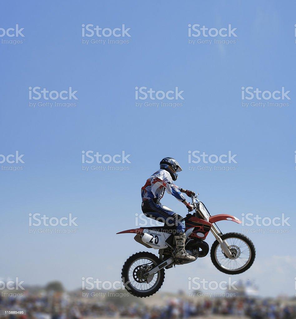 Blue sky over flying motorbike royalty-free stock photo
