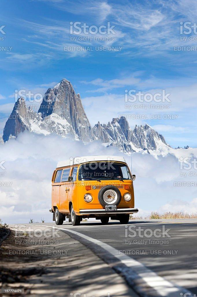 Blue sky over orange Volkswagen mini van stock photo