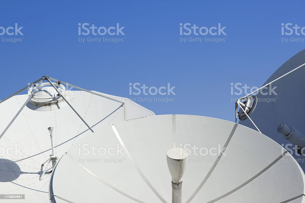 Blue sky over satellite dishes royalty-free stock photo
