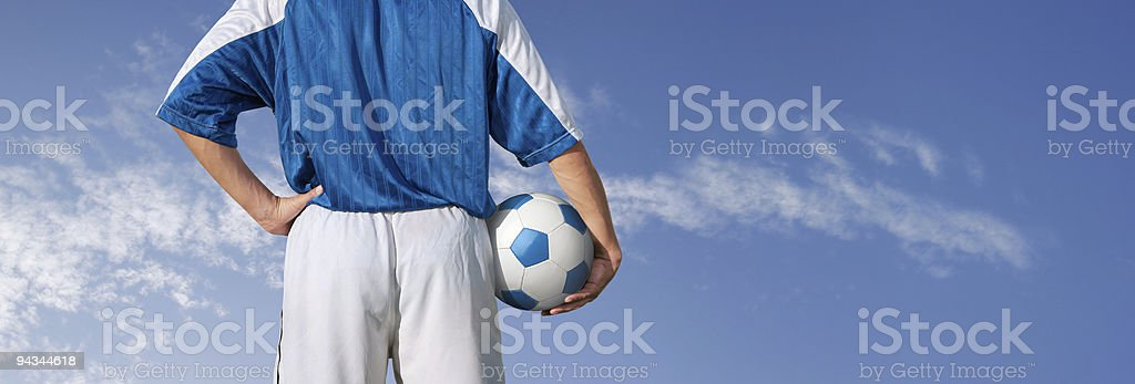 Blue sky over soccer player about to play royalty-free stock photo