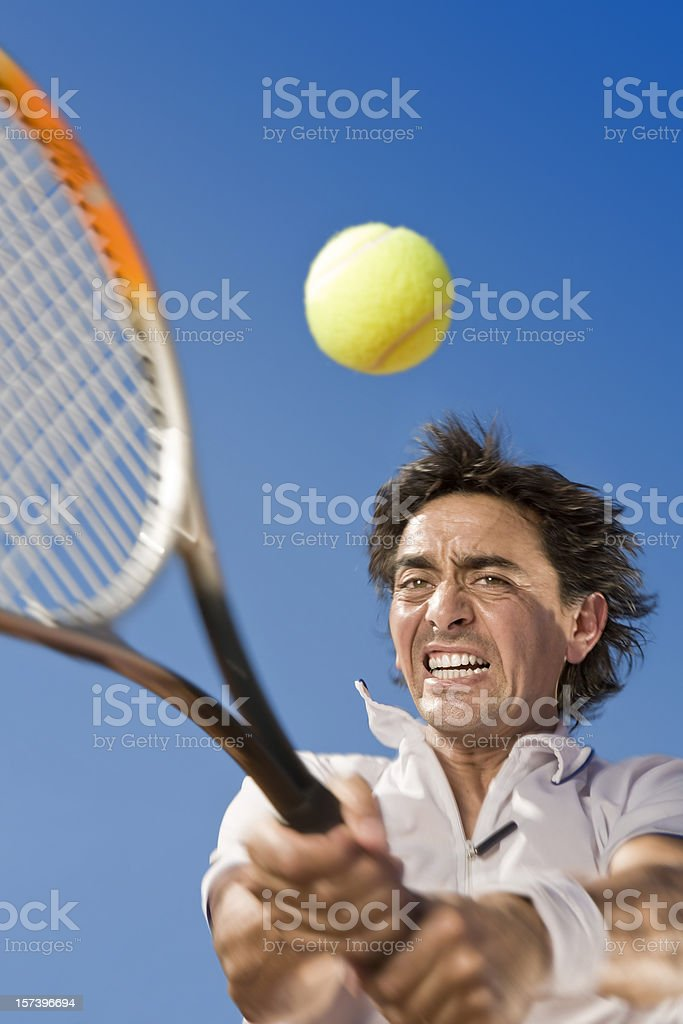 Blue sky over tennis player hitting the ball royalty-free stock photo