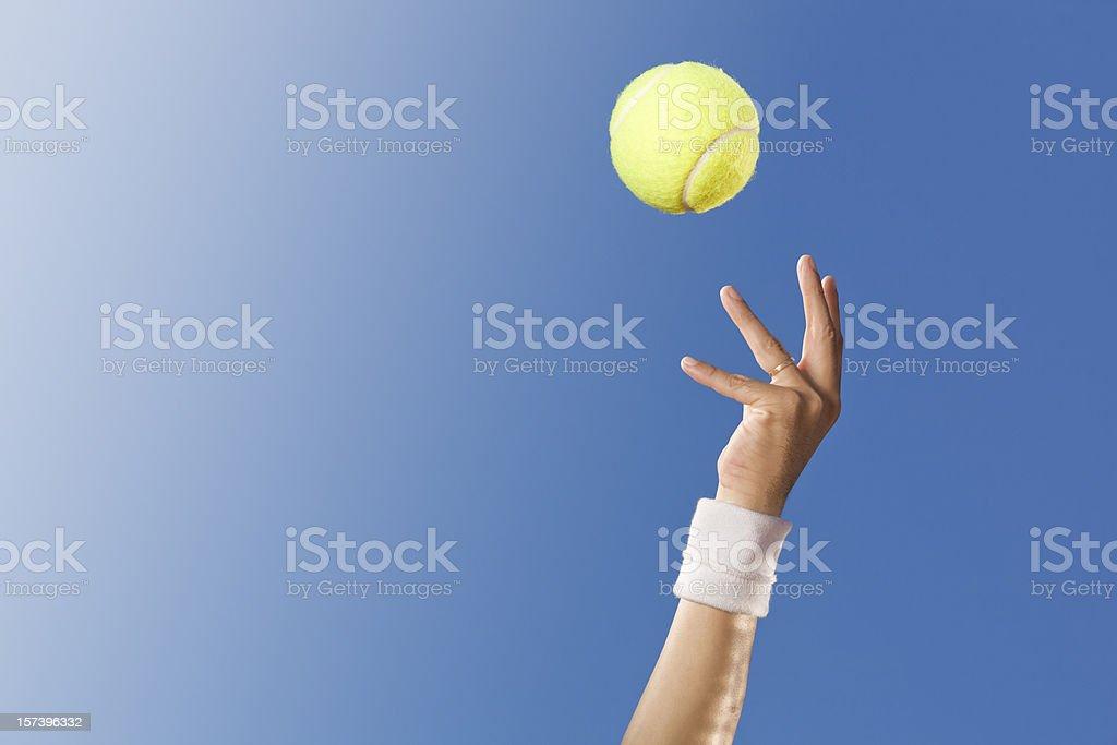 Blue sky over tennis player stock photo