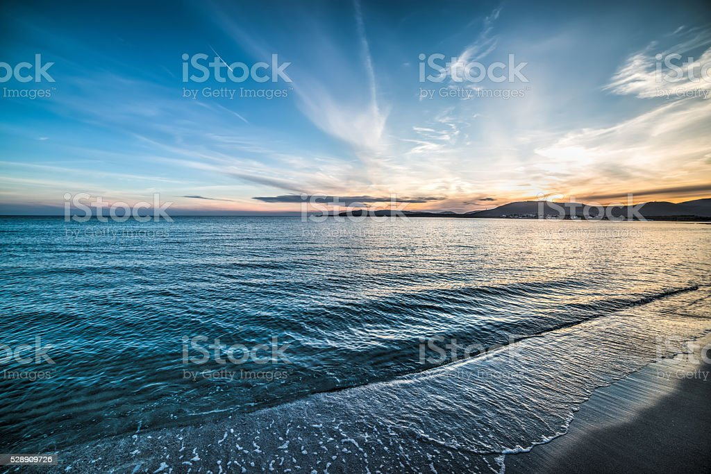 blue sky over the sea at sunset stock photo