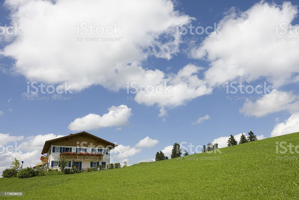 Blue sky over traditional house in Bavaria royalty-free stock photo