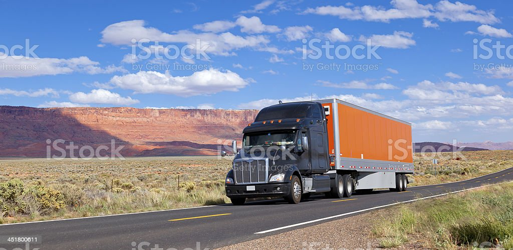 Blue sky over truck driving through Southwest USA stock photo