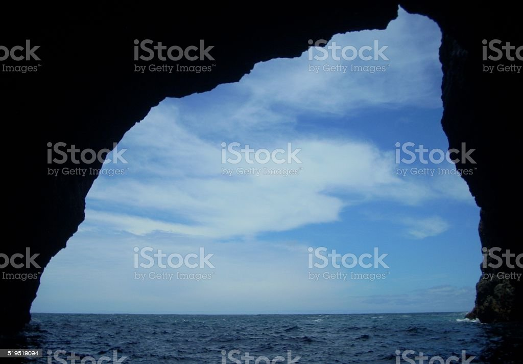 Blue Sky Over Water From Cave stock photo