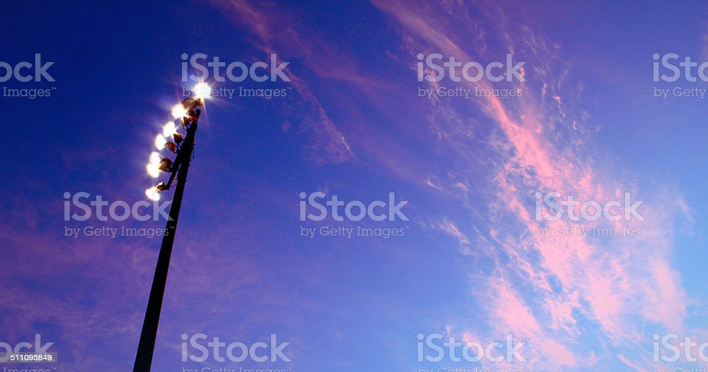 Blue sky pink clouds stock photo