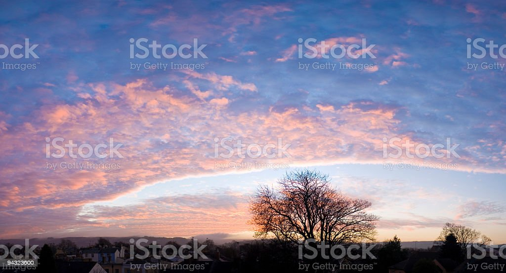 Blue sky, pink illuminated clouds royalty-free stock photo