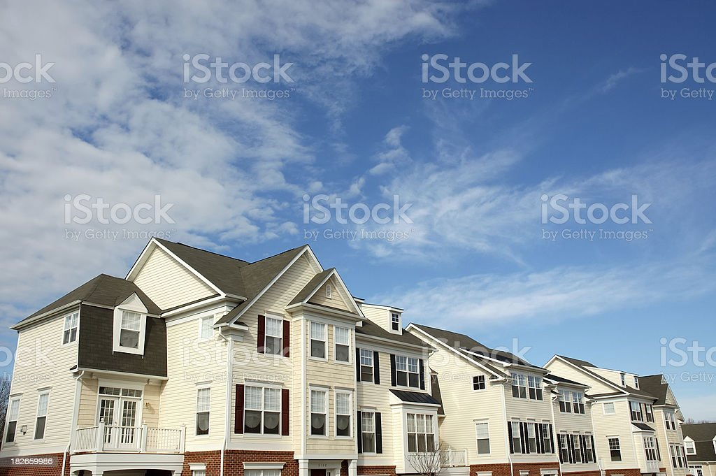 Blue sky townhouse royalty-free stock photo