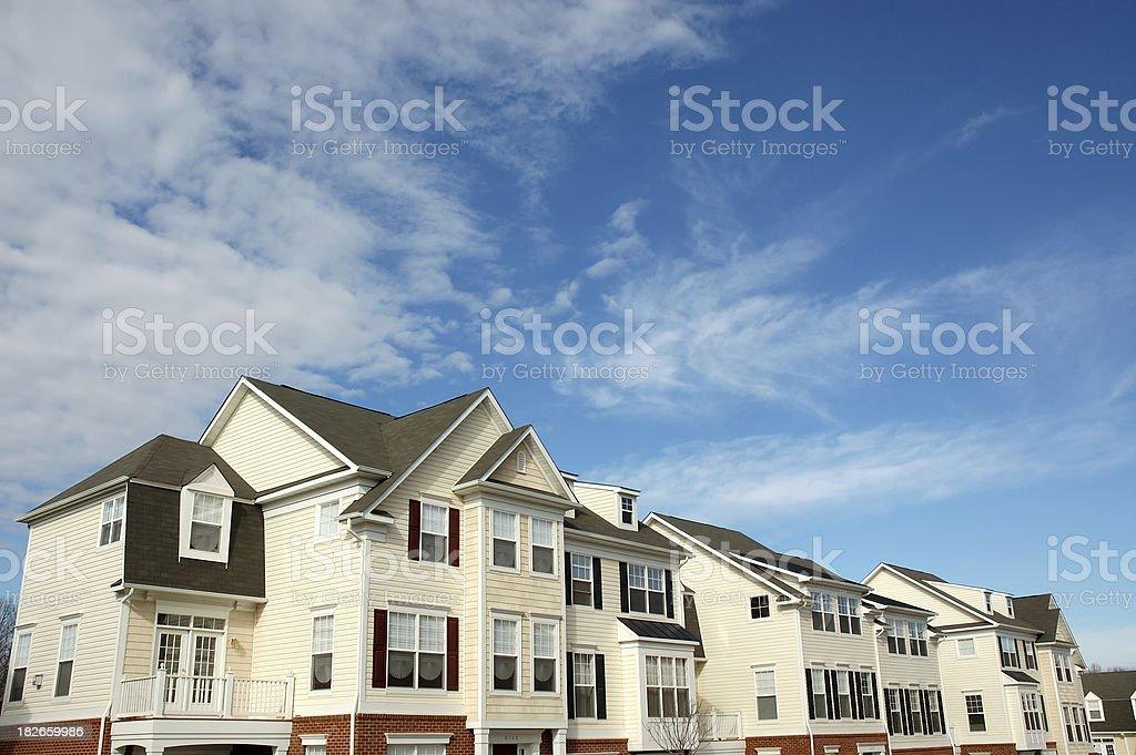 Blue sky townhouse stock photo