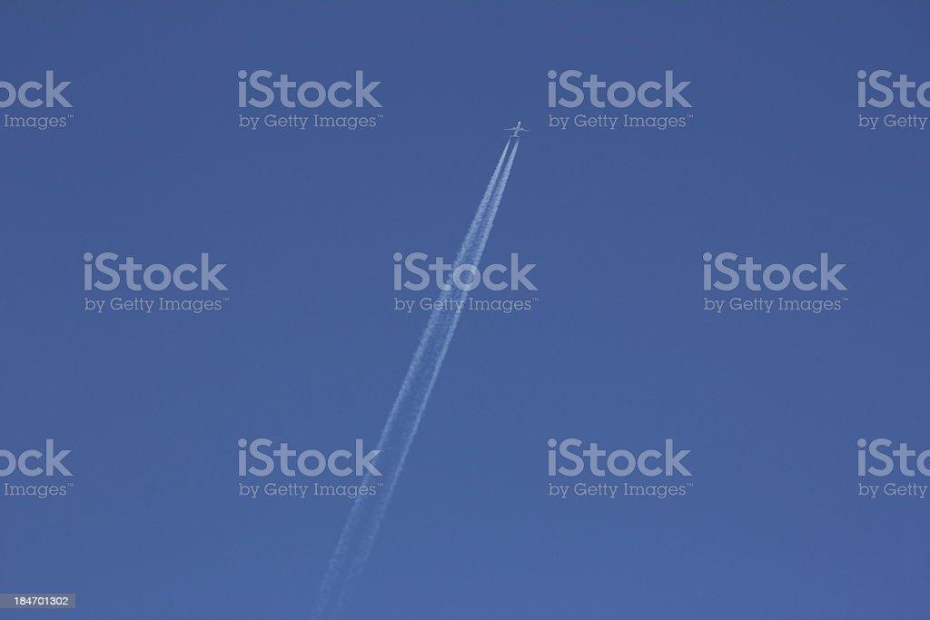 Blue Sky & White Condensation Trail of an Airplane royalty-free stock photo