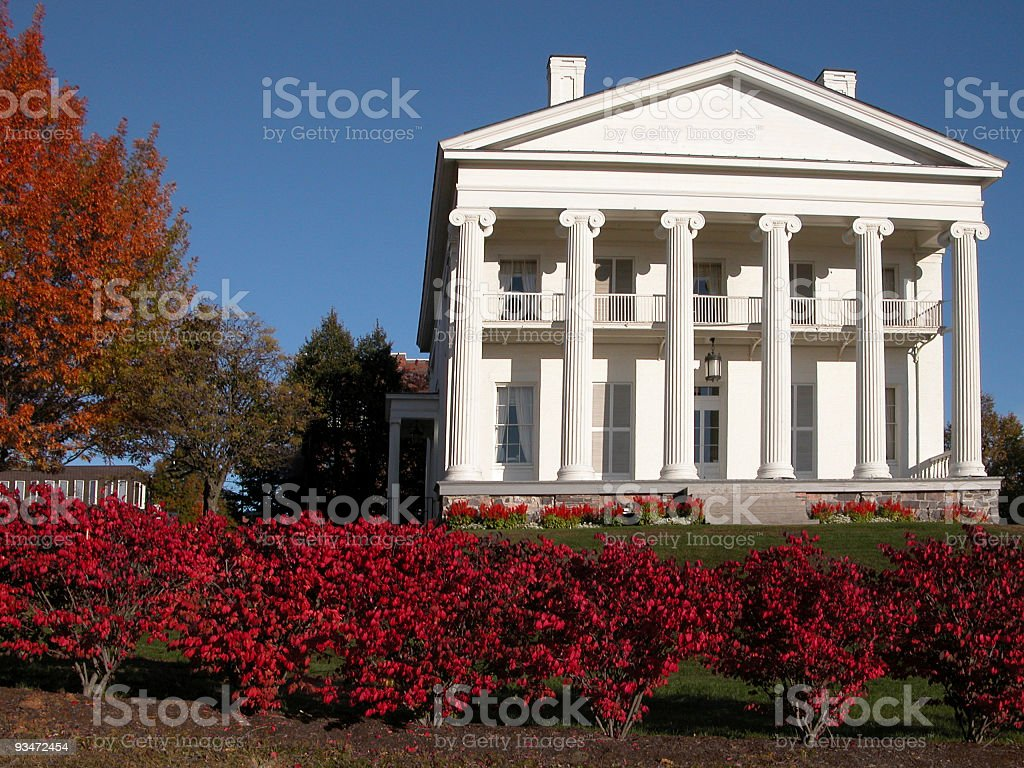 Blue sky, White House, Red Leaves stock photo