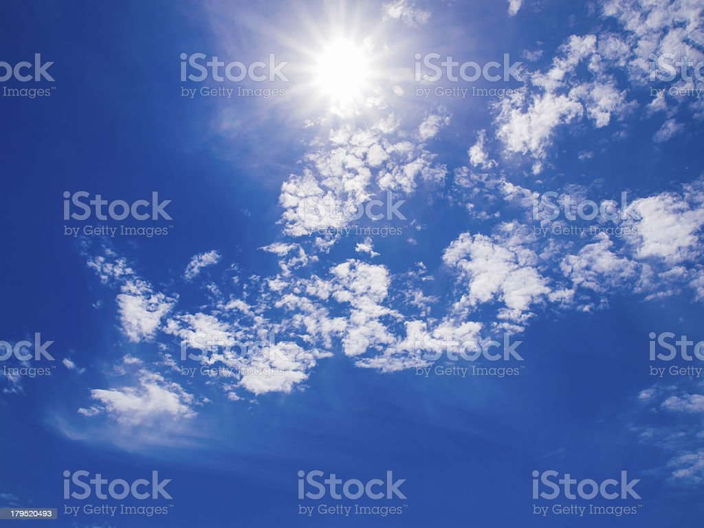 Blue sky with clouds and sun royalty-free stock photo