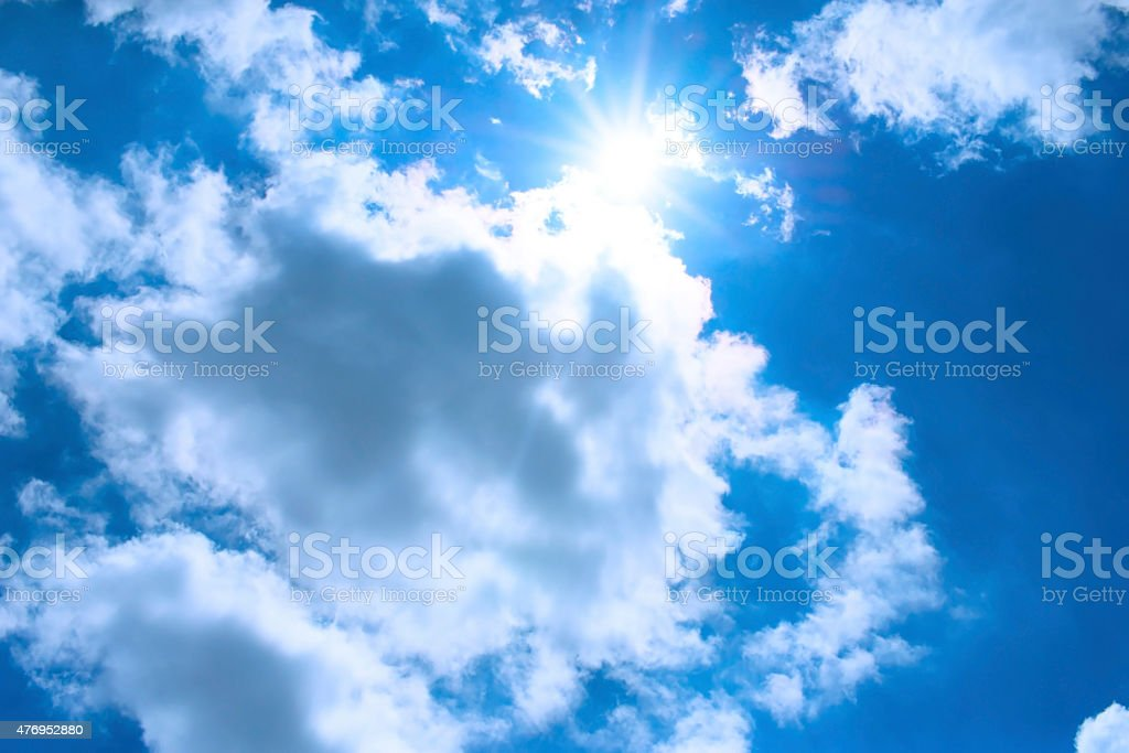Blue sky with clouds and sun. royalty-free stock photo