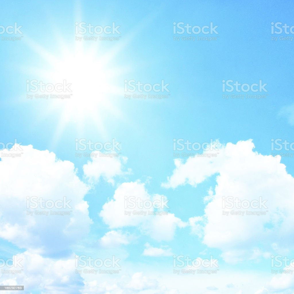 Blue sky with clouds and sun, retro filter effect royalty-free stock photo