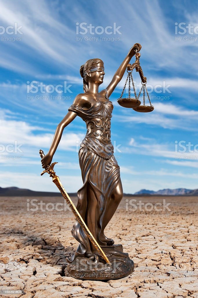 Blue sky with clouds behind Themis on dry lake bed royalty-free stock photo