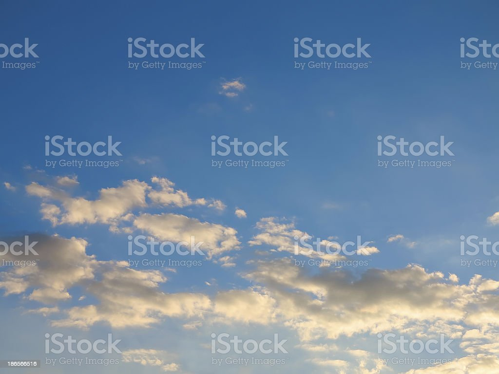 Blue sky with clouds lit by the sunset royalty-free stock photo