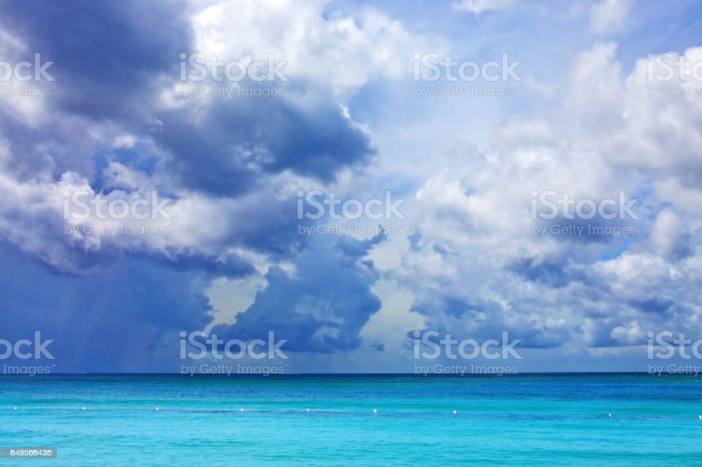 Blue sky with clouds over caribbean sea stock photo