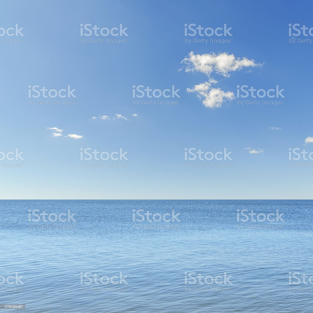 blue sky with clouds over sea stock photo