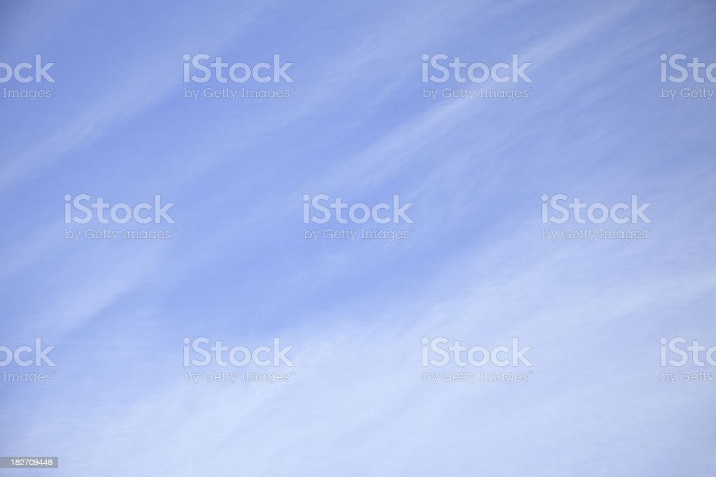 Blue Sky with Diagonal Wispy Cirrus Clouds, Background royalty-free stock photo