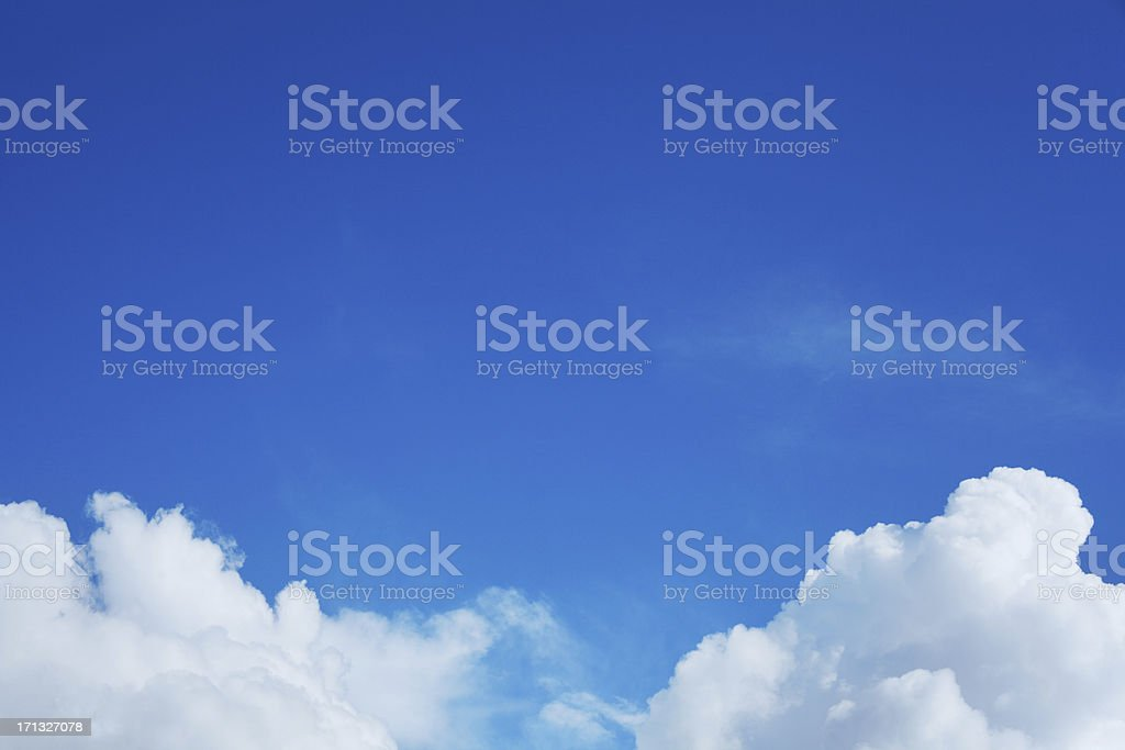 Blue sky with fluffy white clouds royalty-free stock photo