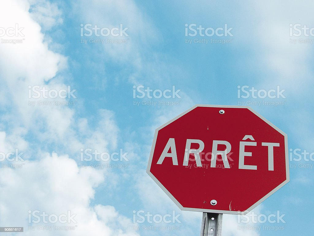 Blue Sky with French Stop Sign royalty-free stock photo