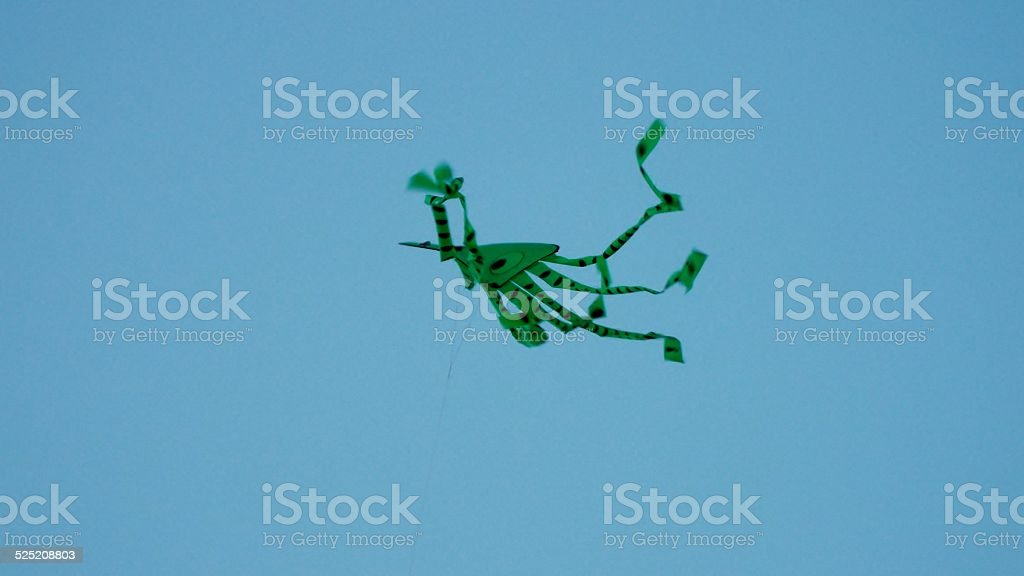 Blue Sky with Green Kite stock photo