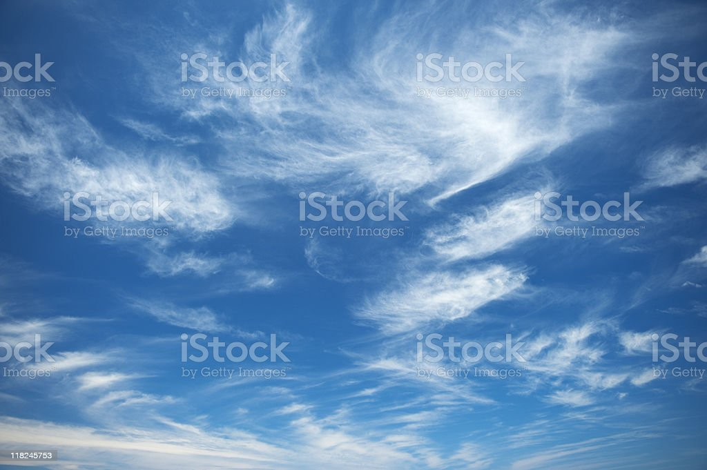 Blue sky with intermittent clouds stock photo