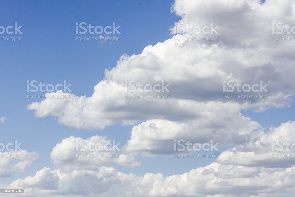 Blue sky with moody clouds royalty-free stock photo