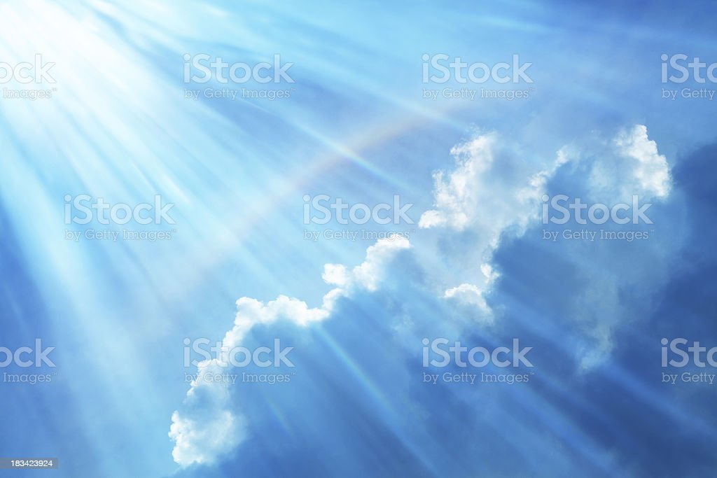 Blue Sky With Rainbow and Sun Reflection royalty-free stock photo