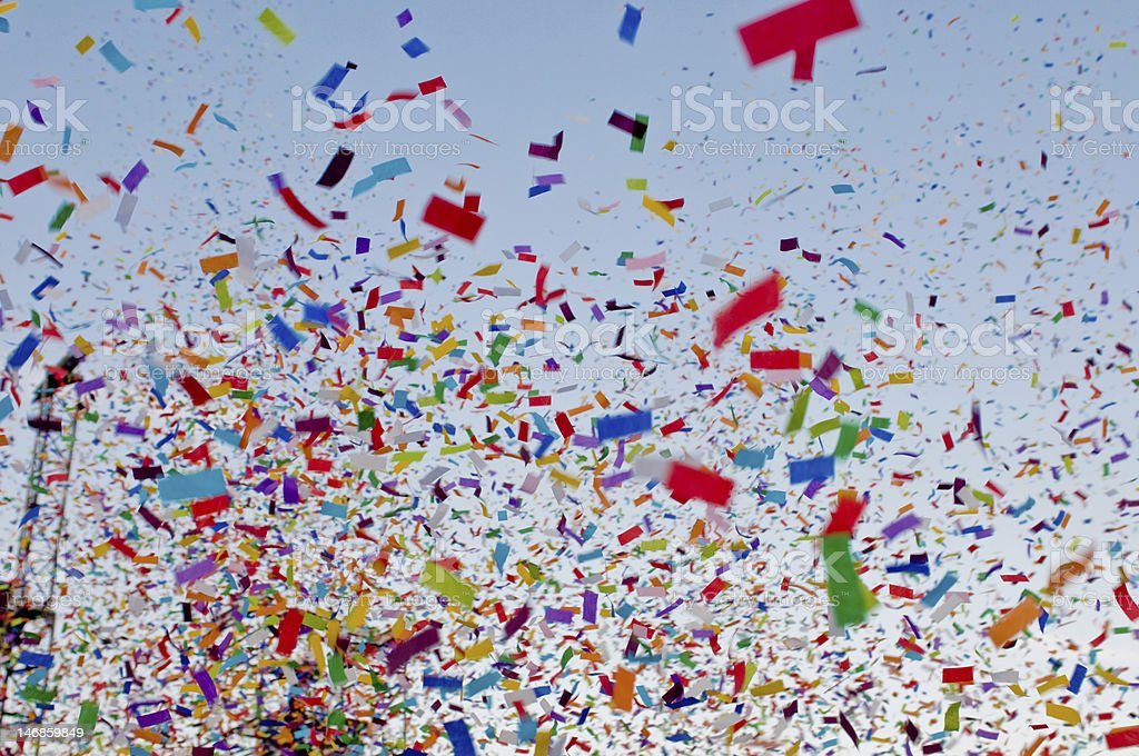 Blue sky with rainbow confetti stock photo