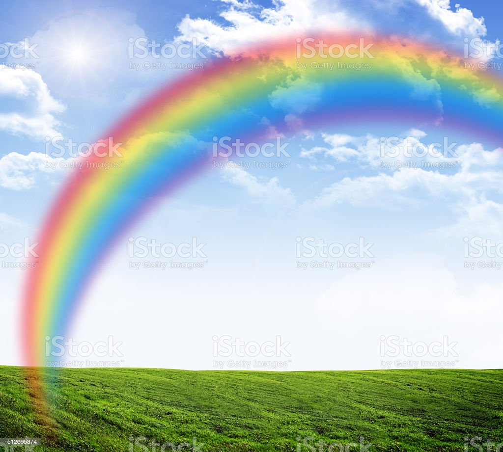 Blue sky with rainbow stock photo
