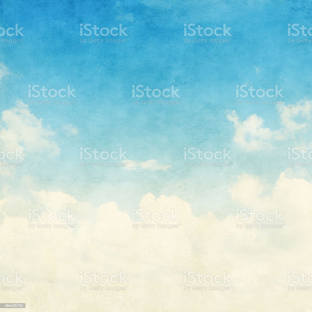 A blue sky with some clouds in the background stock photo