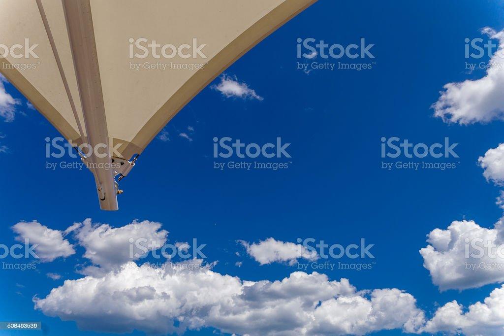 blue sky with umbrella stock photo