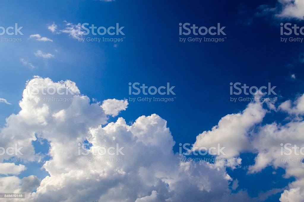 Blue sky with white clouds background. Natural day light stock photo