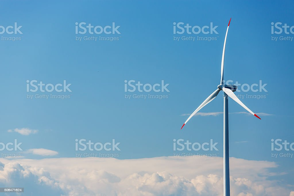Blue sky with wind turbines generating electricity stock photo