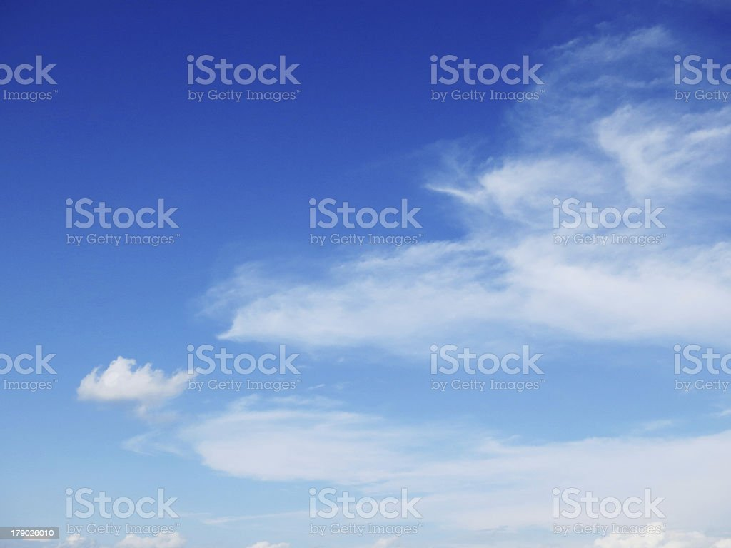 Blue sky with wisps of white clouds royalty-free stock photo