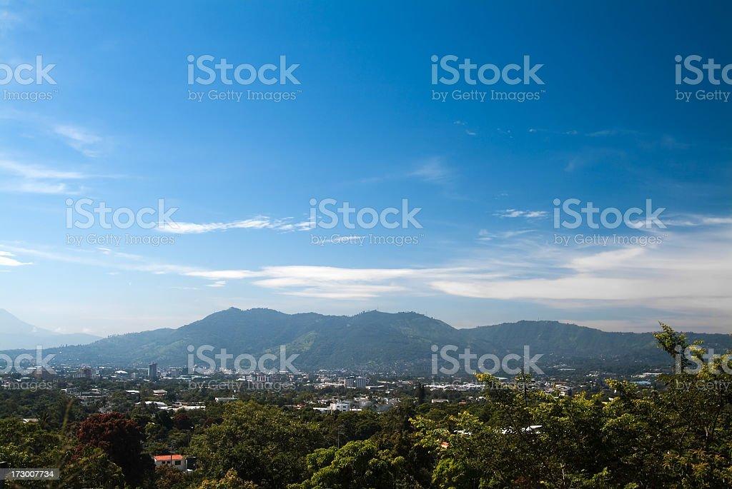 Blue sky with wispy clouds over San Salvador stock photo