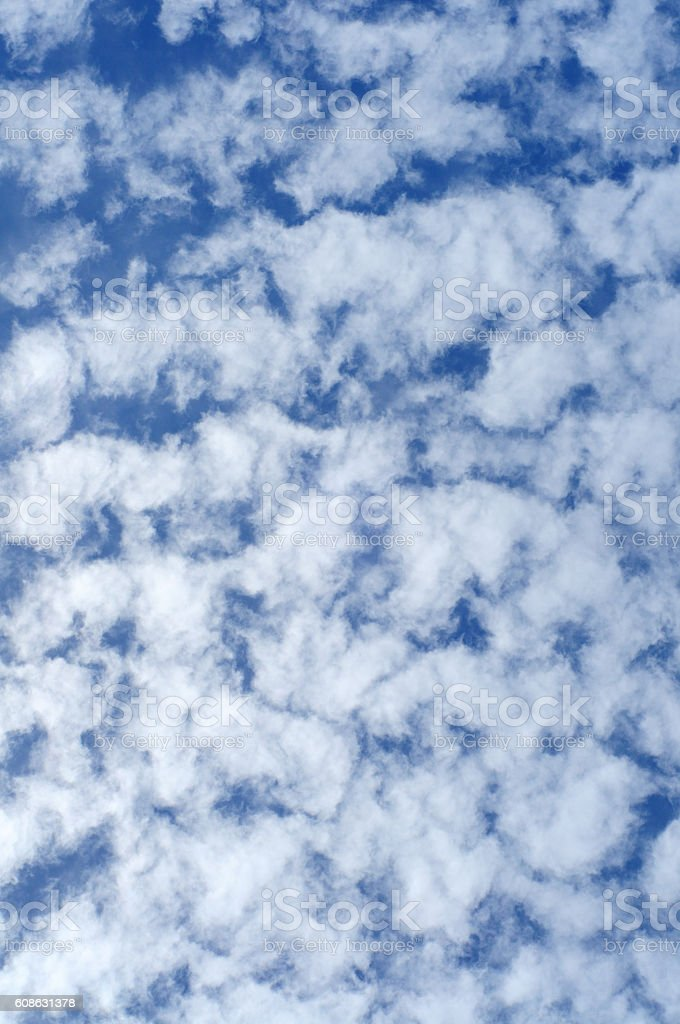 blue sky with wispy clouds, vertical stock photo