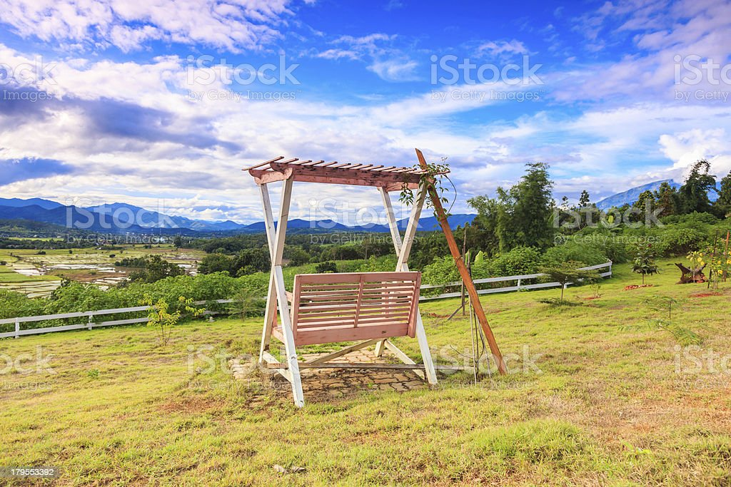 blue sky with  wooden swing in the garden royalty-free stock photo