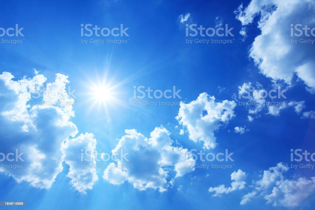 Blue Sky - XXXL Image of Sun Shining Between Clouds royalty-free stock photo