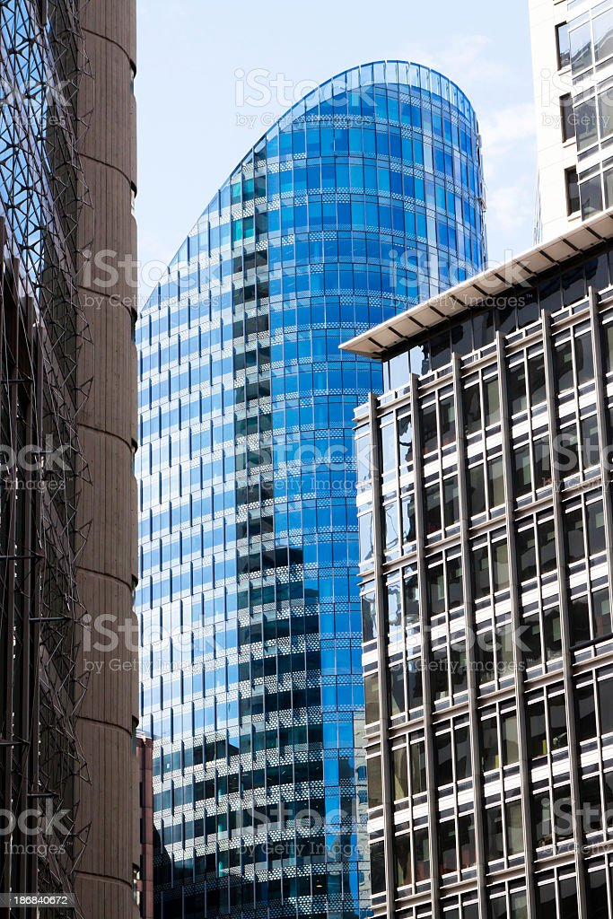 Blue skyscraper with shiny blue glass walls, oval shape stock photo