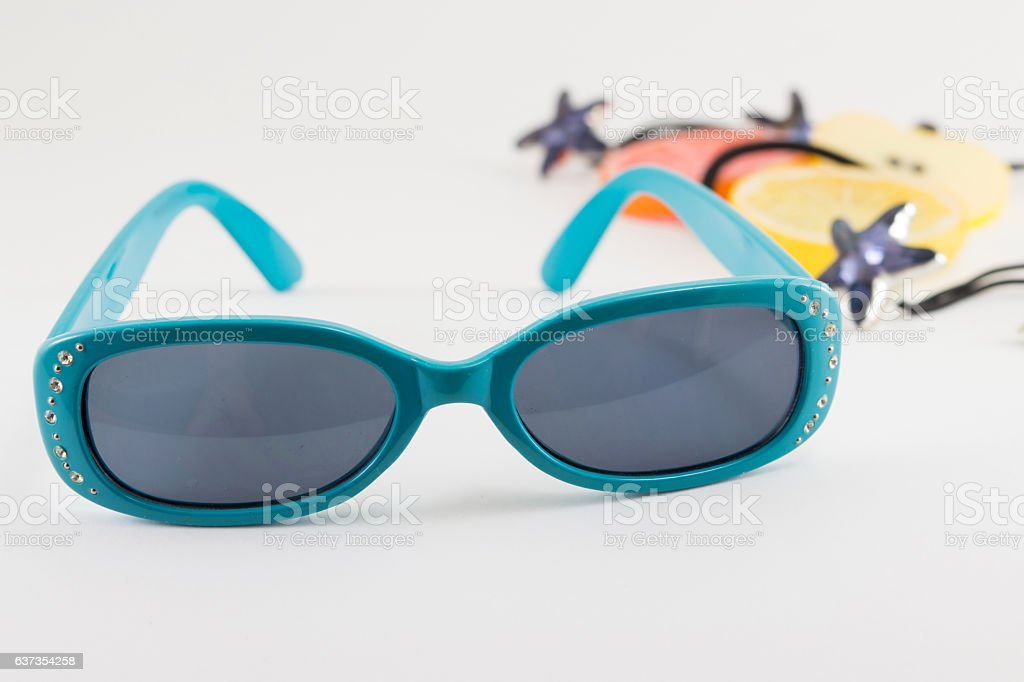 Blue small children sunglasses and accessories on white stock photo