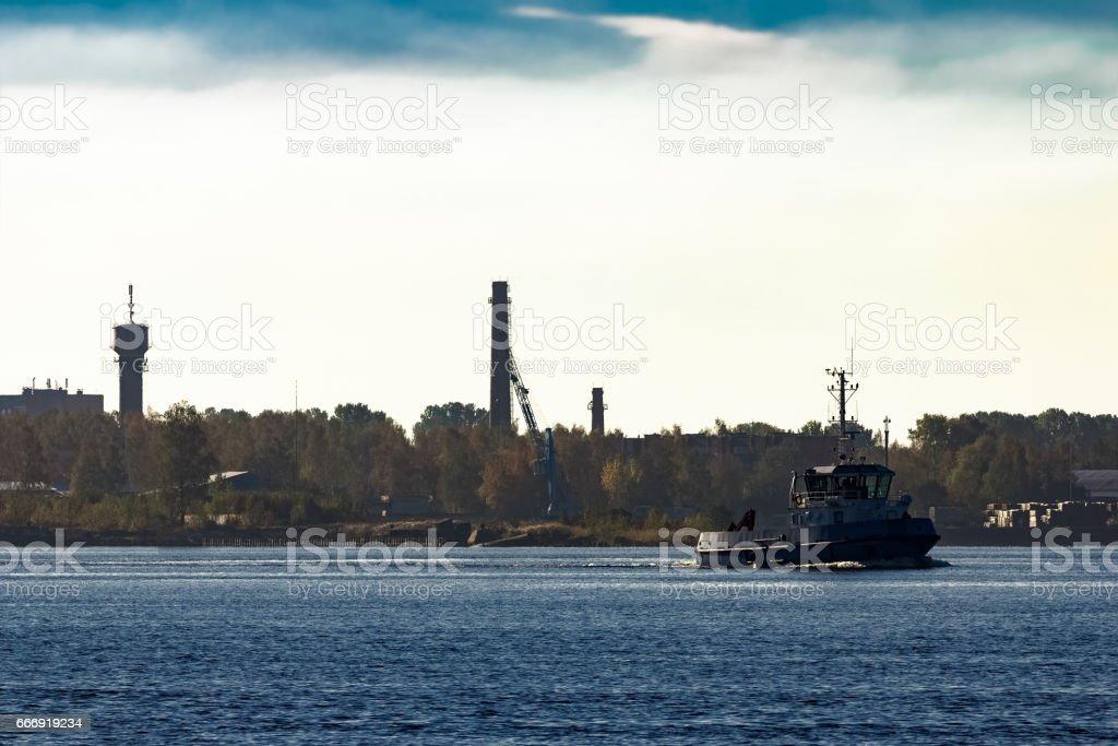 Blue small tug ship stock photo