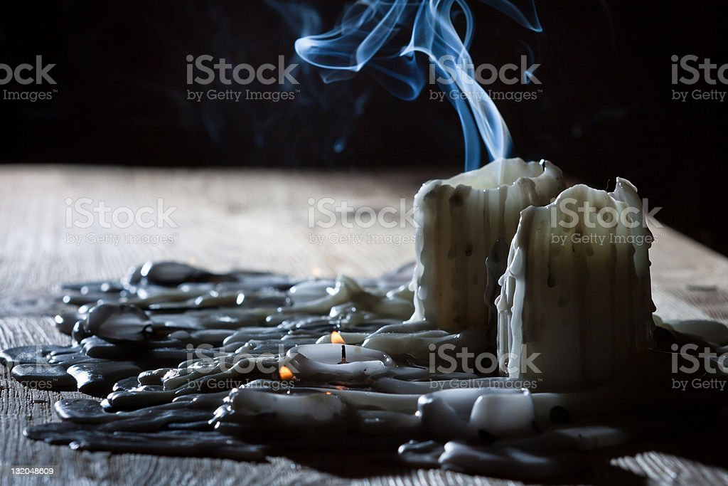Blue smoke from candles stock photo