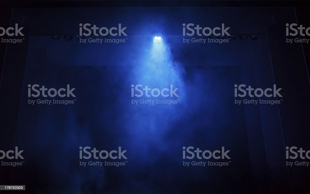 Blue Smoke on a Black Stage stock photo