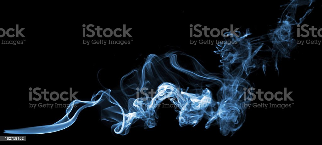 Blue smoke on black background royalty-free stock photo
